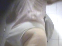 Beautiful angle of a round ass in the bathroom's changing room