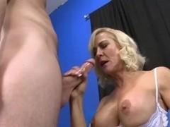Mature hottie fucks a horny younger dude