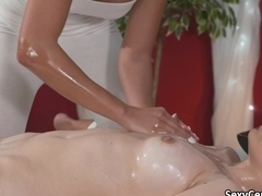 Oiled lesbians fucked on massage table