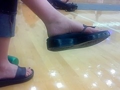 Dangling sandals in the gym