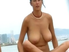 Tanned angel with large melons