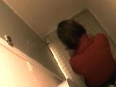 Hot brunette caught in the toilet