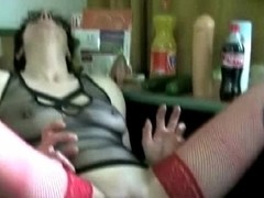 A guy filling some slut's ass with sex toys