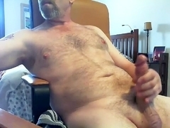 Winsome fagot is having fun at home and filming himself on web camera