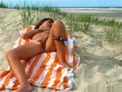 Naughty girl takes off her bikini at the beach and masturbates
