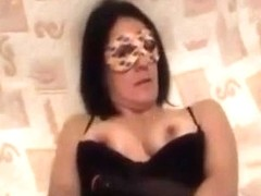 aged mama masked inserts a sex tool and licks it clean