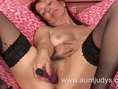 Hot aged vixen copulates herself with a sex-toy
