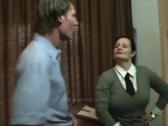 Busty mature dominatrix and her submissive thrall