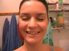 Hot girlfriend masturbates in a shower