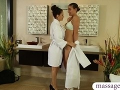 Nuru massage training leads into a lesbian strapon fucking