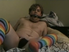 Jerking off with gag and rainbow socks