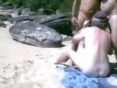 three dads at undressed beach