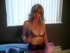 Sexy mother i'd like to fuck sits on the bed showing off her sexy marangos and smokes