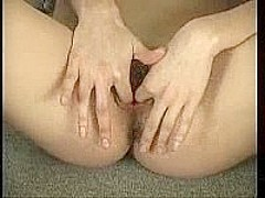 Girl masturbates with two hands