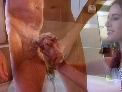 Rampant babe suds up & tosses off this old man's dick