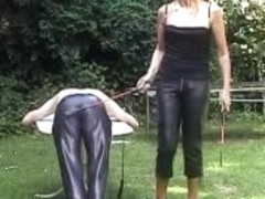 Sissy serf gets caned in the open air