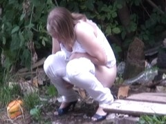 Two nude butts of pissing females shot on voyeur cam outdoor