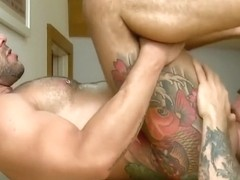 Muscle tattoo guy gets a big cock