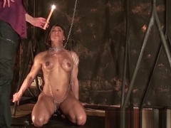 Hot muscled MILF in a homemade BDSM scene with candles