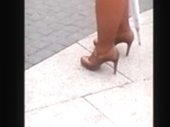 Woman with hot ass and legs in mini skirt and high heels