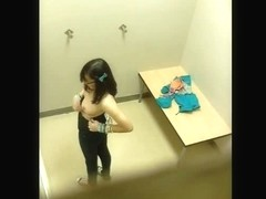 Nerdy hot babe showing her huge tits in the changing room