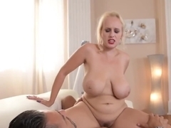 Passionate blonde with red lips, Angel Wicky is giving a deep blowjob to Mugur, before fucking him
