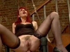 Redhead MILF domina tortures her slave