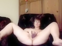 Pale skin Eastern European cougar masturbating on web camera