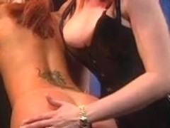 Dominatrix-Bitch with red hair arse whips angel