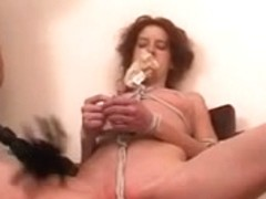 Redhead mother i'd like to fuck fastened with rope and her undies poked in her face hole