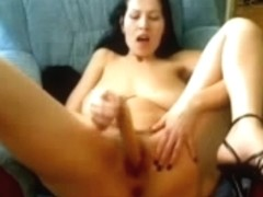 Mature female with large saggy tits strips on webcam