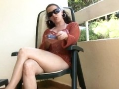 Brunette whore masturbating while smoking in the balcony