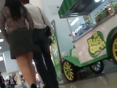 MILF upskirts hidden camera shots in a store