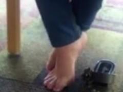 cute teen feet under table