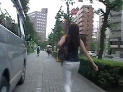 Candid ass video with girl in tight light trousers