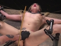 Gagged blonde vibed in device bondage