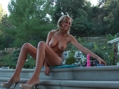 Big Titted Blonde gives herself orgasms by the pool