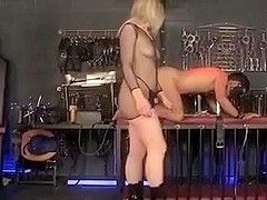 Mistress milks her slaveboy, and uses her toys on him.