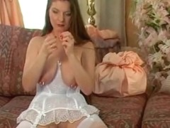 German Gal plays with her big pierced nipps two