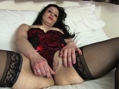 An old wife toying her gaping muff