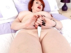 British milf Red gets ready for filth in tight leggings