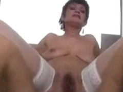 Hairy Mature gets it in her arse