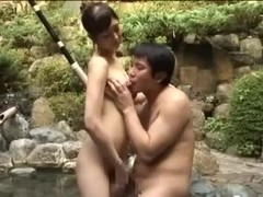 Breasty slut fucking an Asian guy in a pool