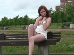 Russian redhead showing her tight pussy in public