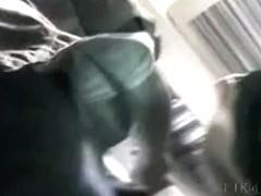 Scantily clad model filmed by an upskirt voyeur
