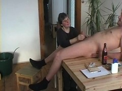 Granny Gives A Irrumation On The Kitchen Table