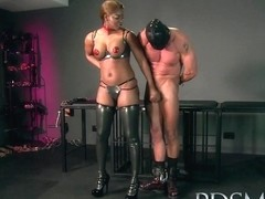 Slave boy enjoys a good beating from his Dom before licking his cum from her shoe