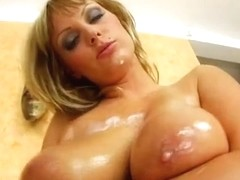 Sheila is a blonde with double D cup boobs and a very roundfirm ass.