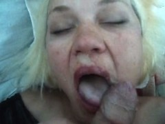Mature blonde receiving a load of warm cum in her mouth