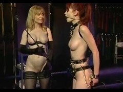 Curvy redhead dominated in BDSM threesome